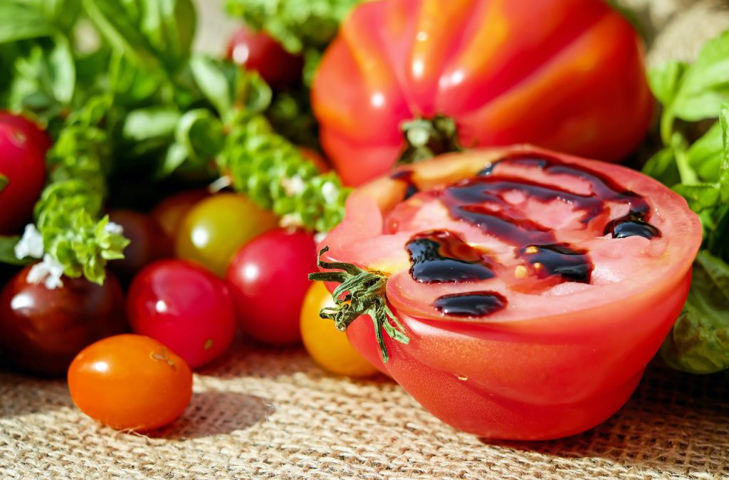 Healthy food with tomato in focus